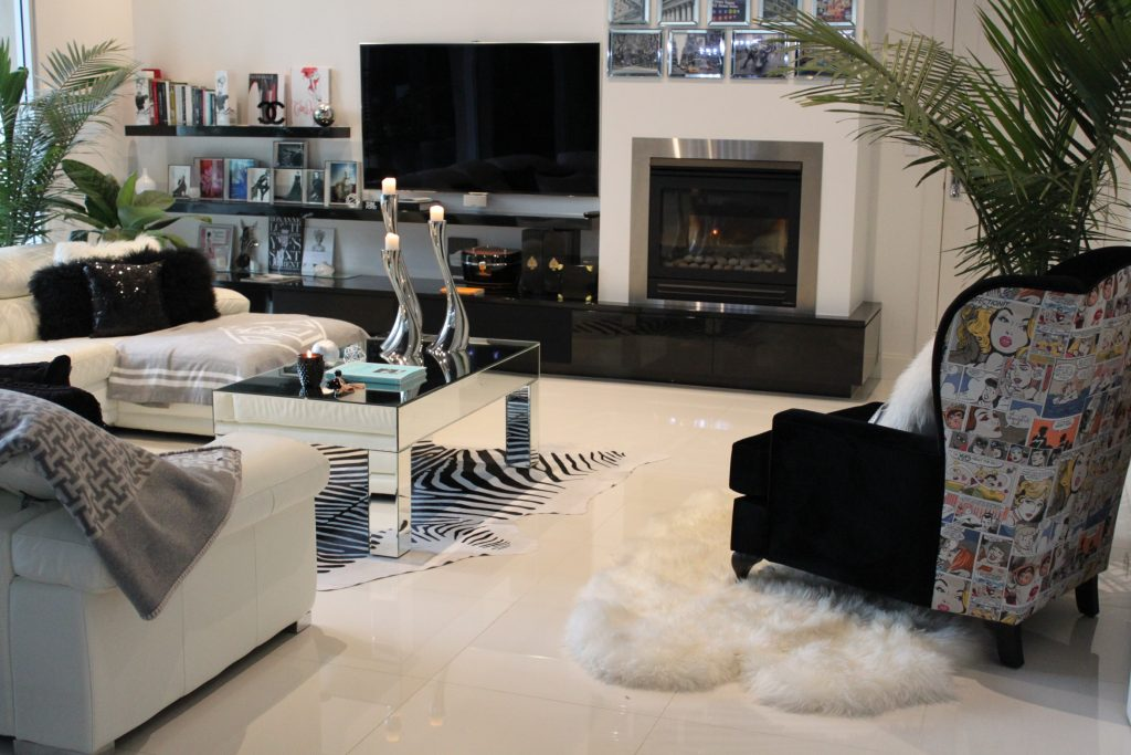Black and White Lounge room with black velvet feature chair